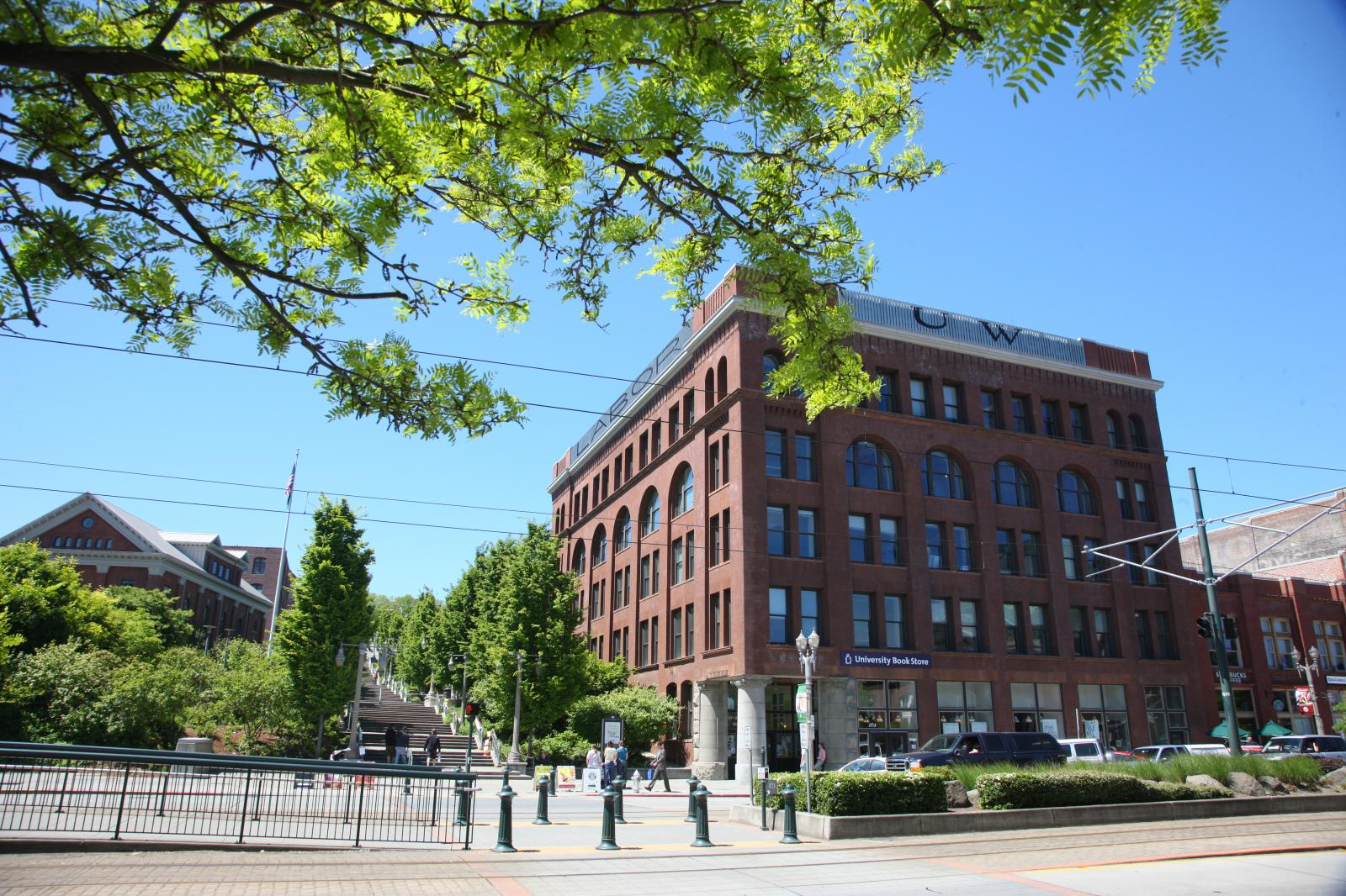 "Image showing UW Tacoma academic building with a large sign on top, reading ""U.W."""