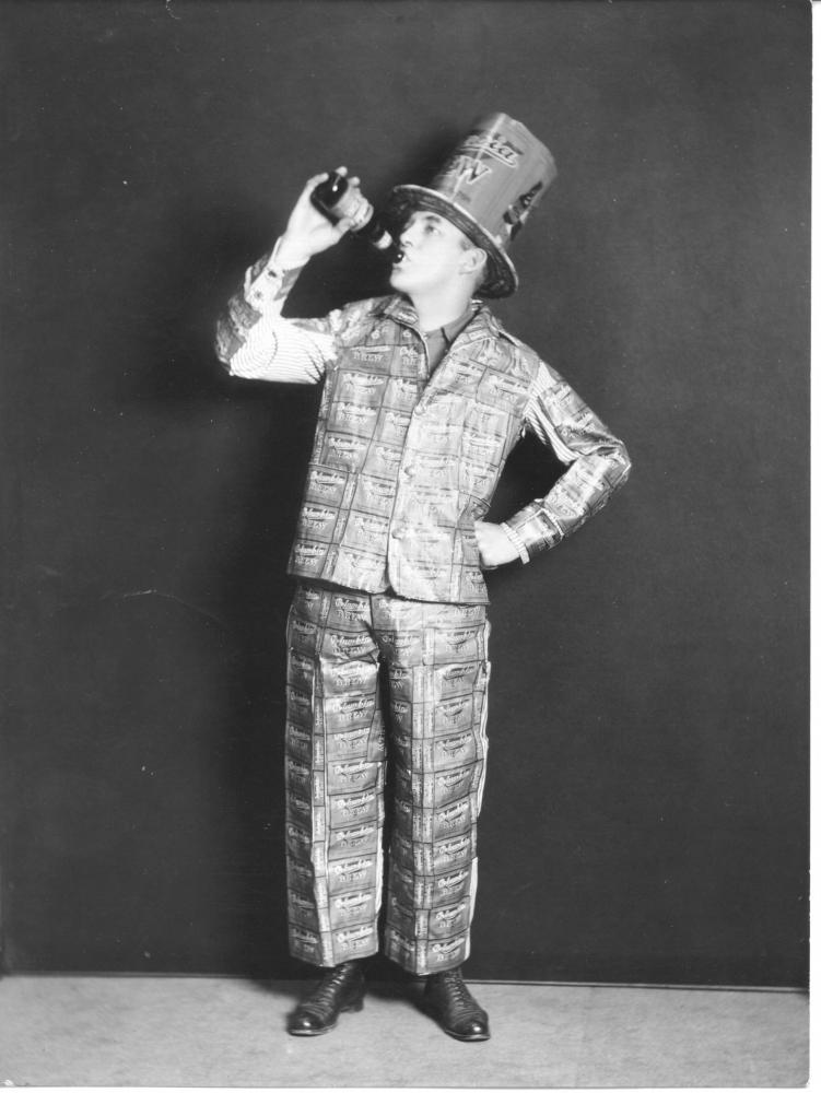 "A fan of Columbia Brewing Company's ""near beer"" models a suit for not-just-any occasion. The jacket and pants have been made from Columbia Brew labels. (Photo by Richards Studio, used with permission from Tacom"
