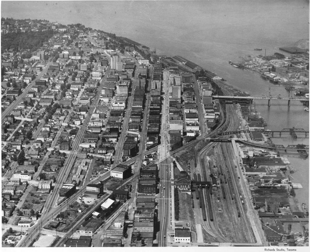 An aerial view of the city (1948). Prairie Line Trail in the center. Thea Foss Waterway off to the right (photo by Richards Studio, used with permission from Tacoma Public Library).
