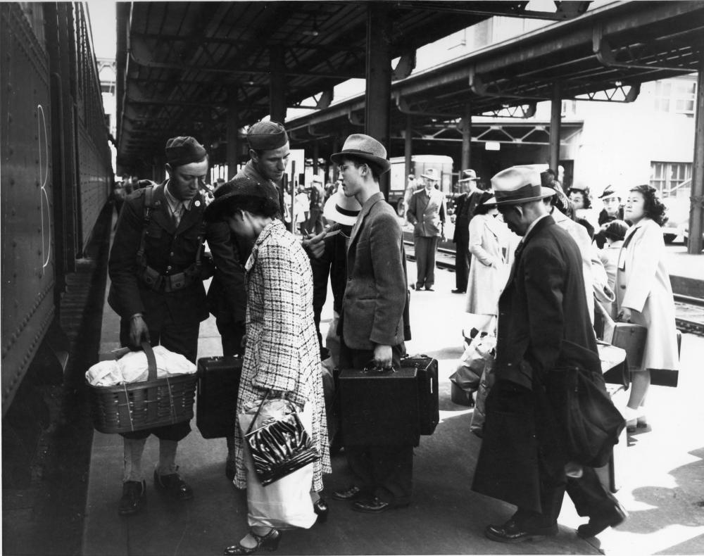 Their presence on the coast considered a national security threat, Tacomas Japanese Americans boarded a train at Union Station to an internment camp (Photo by Richards Studio).