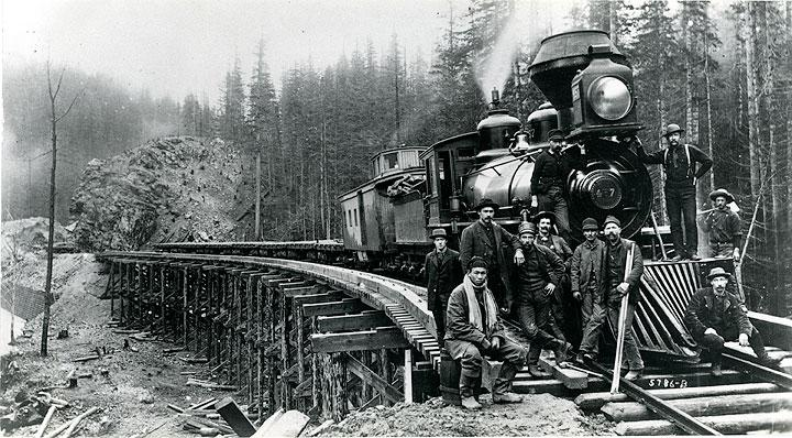 Workers earned an average of $1 a day building NPRR's Cascade Branch (Photo ca. 1885, Stampede Tunnel Line, used with permission from Washington State Historical Society).