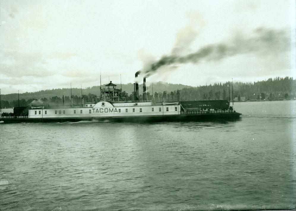 "Side view of ""Tacoma,"" a Northern-Pacific-owned ferry loaded with passengers and a train (ca. 1900, photo used with permission from Washington State Historical Society)."