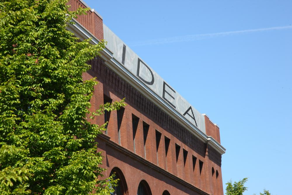 "A sign at the top of the UW academic building reading ""IDEA"""