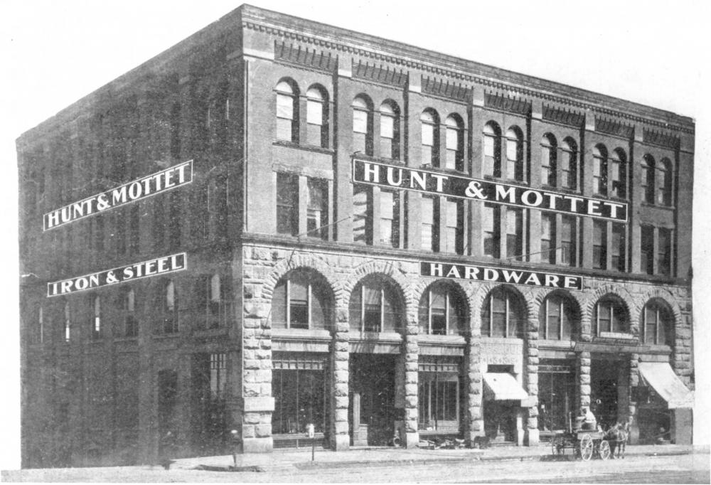 The Sprague Building in 1890, the year it was built, with a horse-drawn carriage near the front door.